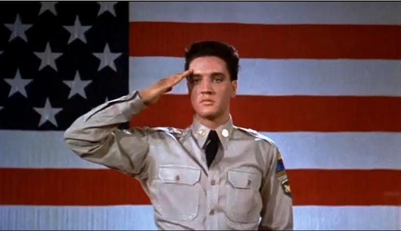 Army Elvis Saluting in front of US Flag
